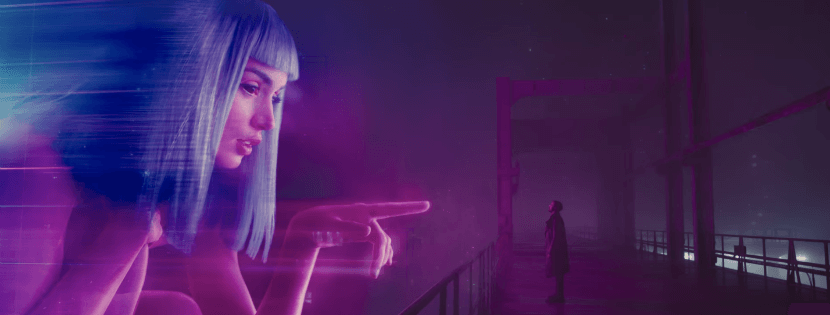 A huge holographic woman points at actor Ryan Gosling's character in the film Blade Runner 2049.