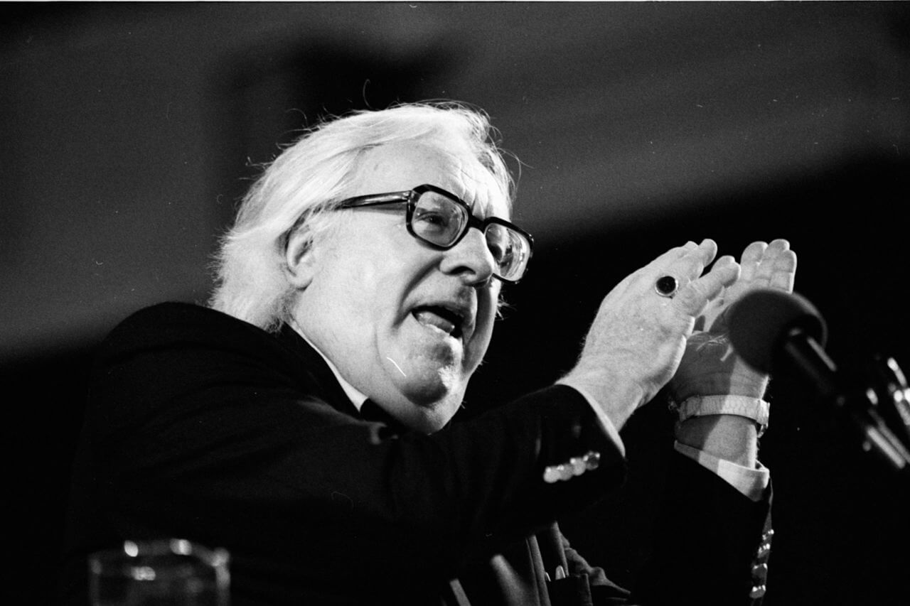 American author Ray Bradbury stands in front of a microphone at the 1990 Miami Book Fair International.